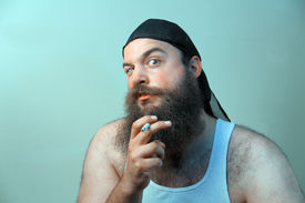 picture of wife-beater  - A smoking redneck is disturbed by what he sees  - JPG