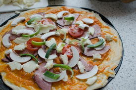 stock photo of doma  - Home made pizza with pork tomato salami and soda - JPG