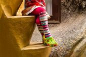 image of pantyhose  - Little girl in colorful pantyhose sitting on stone stairs  - JPG