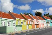 stock photo of curacao  - Row of houses painted in vibrant colors at Punda district of Willemstad - JPG