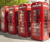 image of phone-booth  - Row of 4 red telephone booths in London - JPG