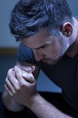 picture of grieving  - Gloomy portrait of young man with depression  - JPG