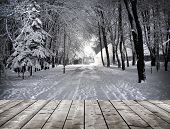 stock photo of floor covering  - Winter park in the evening covered with snow with wooden floor - JPG