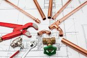 image of pipe wrench  - Plumbing Tools Arranged On House Plans whit wrench and pipe cutter - JPG