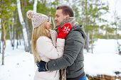 picture of amor  - Young amorous couple embracing in winter outside - JPG
