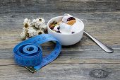 pic of yogurt  - Diet breakfast with granola and yogurt on rustic wooden background - JPG