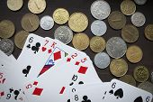pic of copper coins  - Various coins and poker cards top view composition - JPG