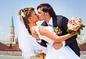 picture of hand kiss  - Young wedding couple kissing - JPG