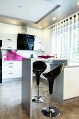 pic of stool  - Small table with stools in the new modern open kitchen - JPG