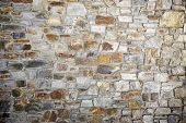 foto of homogeneous  - Stone wall background at high resolution - JPG