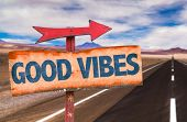 pic of universal sign  - Good Vibes sign with road background - JPG