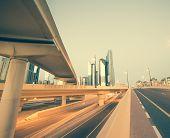 stock photo of dubai  - Skyscraper roads and bridge at the Sheikh Zayed Road in Dubai in the evening - JPG