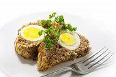 foto of meatloaf  - slices of baked meatloaf with boiled eggs inside for Easter on white background - JPG