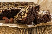stock photo of brownie  - Cocoa and chocolate brownies dessert with hazelnut - JPG