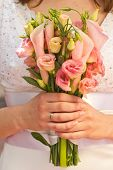 stock photo of calla  - Beautiful wedding bouquet of calla and eustoma flowers in hands of the bride - JPG