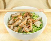 stock photo of pork  - Asian style red pork and fried pork noodles - JPG