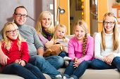 stock photo of extended family  - Family sitting together with mother - JPG