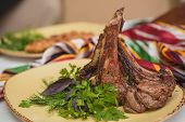 stock photo of veal  - Grilled organic veal fillet on yellow plate with salad - JPG