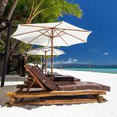 foto of boracay  - Sun umbrellas and beach chairs on a beautiful island Philippines Boracay - JPG