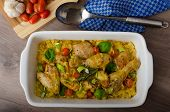 stock photo of curry chicken  - Roasted chicken quarters with curry vegetables cauliflower tomatoes and leek - JPG