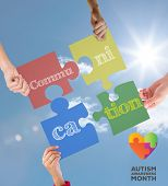 image of aspergers  - autism awareness month against bright blue sky with clouds - JPG