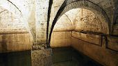 stock photo of underground water  - Old historical underground water well in medieval environment - JPG
