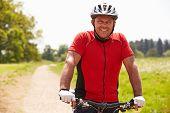 pic of bike path  - Man Riding Mountain Bike Along Path In Countryside - JPG