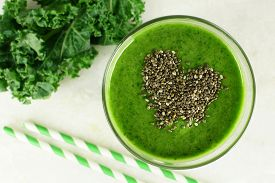 picture of seed  - Green kale smoothie downward view in glass with heart shape made of healthy chia seeds - JPG