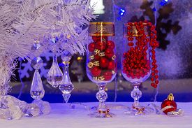 stock photo of champagne color  - glasses of champagne Christmas tree Christmas balls on the background of the winter window - JPG