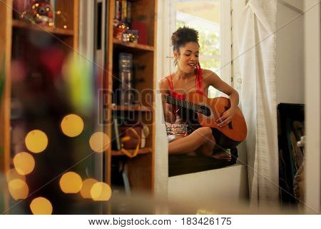 poster of Black Woman Singing And Playing Guitar At Home