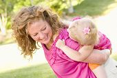 image of mother child  - Mother and Daughter Piggyback Ride in the Park - JPG