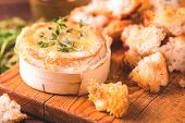 French Baked Camembert Cheese With Thyme And Baguette Bread poster