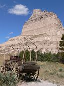 picture of western nebraska  - An old wagon and rock formation in Scottsbluff National Monument located in western Nebraska - JPG