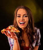 Woman eating slice of Italian pizza . Student consume fast food. Healthy eating and diet concept on  poster