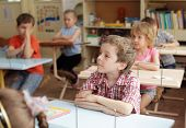 stock photo of school child  - Children at a lesson in school - JPG