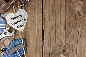 Happy Fathers Day Metallic Heart With Side Border Of Tools And Ties On A Wooden Background poster
