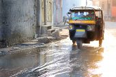 picture of rickshaw  - motor rickshaw in jaipur after monsoon or flood - JPG