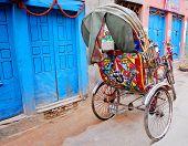 stock photo of rickshaw  - colorful nepalese rickshaw in kathmandu - JPG