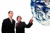businessman showing earth