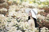 Women And Flowers ,outdoor Portrait Of A Beautiful Women With Flowers,beautiful Woman Wearing A Hat, poster