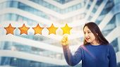 Young Woman Touching Digital Screen Interface Choosing Five Stars Rating, Positive Feedback. Excelle poster