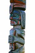 stock photo of indian totem pole  - Wooden totem pole isolated on white background - JPG