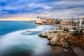 Sitges Is Known For Its Beaches, Nightspots, And Historical Sites. The Beach Seen Here Is Playa San  poster