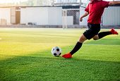 Soccer Player Speed Run To Shoot Ball To Goal On Artificial Turf poster