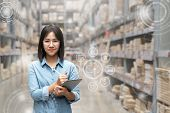 Portrait Of Happy Young Attractive Asian Entrepreneur Woman Looking At Camera Using Smart Tablet In  poster