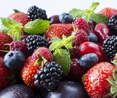 Ripe Strawberries, Blackberries, Blueberries, Raspberries, Red Berries Abd Plum. Mix Berries And Fru poster