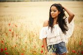 image of mixed race  - Young african woman outdoors - JPG