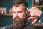 Barbers Hand With Hair Clipper Trimming. Stylish Haircut Concept. Hands Of Barber With Clipper Close poster