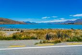 Beautiful Wide Look Over Lake Tekapo In New Zealand, Majestic Mountain Lake In New Zealand, Lake Tek poster