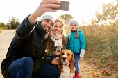 family, pets and people concept - happy mother, father and little daughter with beagle dog taking se poster